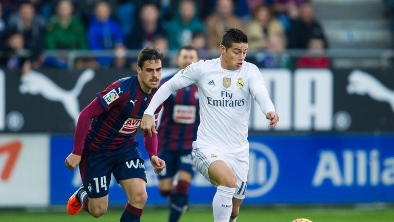 James Rodriguez of Real Madrid (right) duels for the ball with Daniel Garcia of SD Eibar