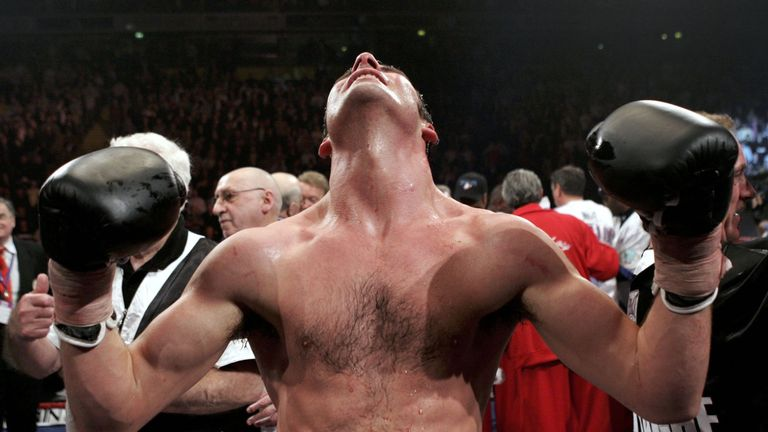MANCHESTER, ENGLAND - MARCH 5:  Joe Calzaghe celebrates his win against Jeff Lacy during the WBO and IBF super middleweight unification title fight at the