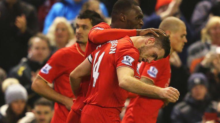 Jordan Henderson of Liverpool is congratulated by Christian Benteke after scoring