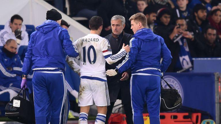Jose Mourinho the manager of Chelsea speaks with Eden Hazard
