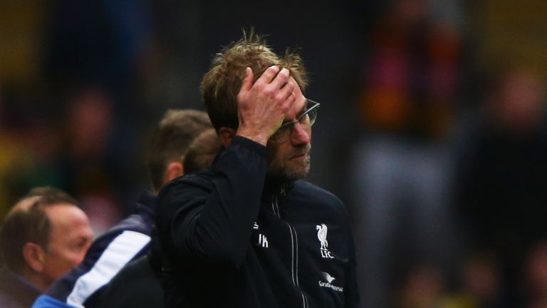 Jurgen Klopp manager of Liverpool reacts as Odion Ighalo of Watford scores their third goal during the Barclays Premier Le