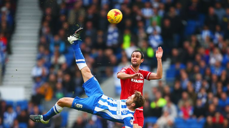 Dale Stephens of Brighton clears the ball from Kike