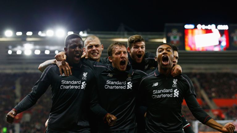 Divock Origi (left) hit a hat-trick as Liverpool thrashed Southampton to reach the Capital One Cup semi-finals