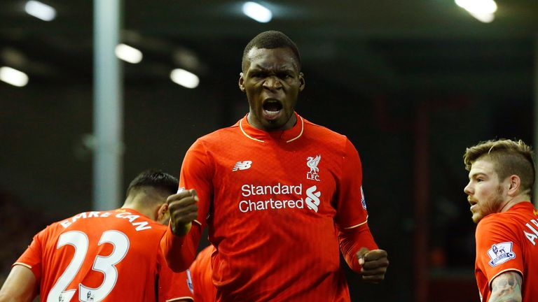 Liverpool's Christian Benteke (centre) celebrates scoring the opening goal against Leicester City at Anfield