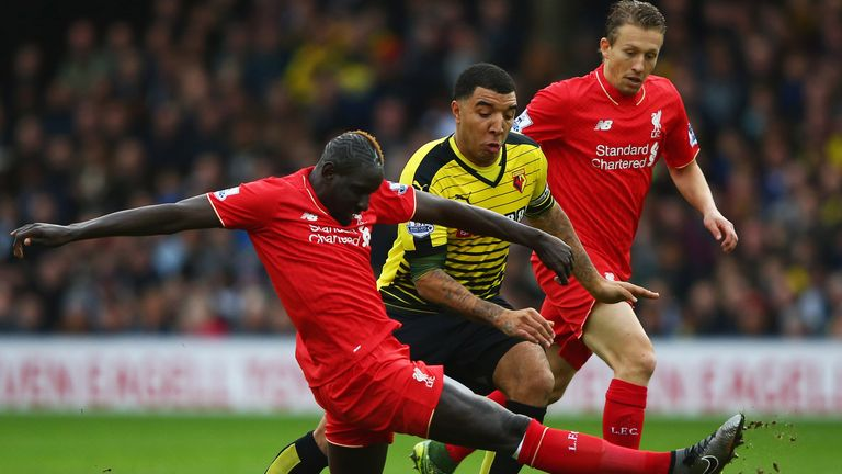 Troy Deeney of Watford takes on Mamadou Sakho and Lucas Leiva of Liverpool