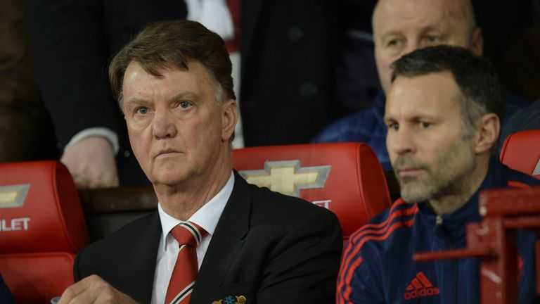 Van Gaal (L) takes his seat next to assistant manager Ryan Giggs (R) at Old Trafford