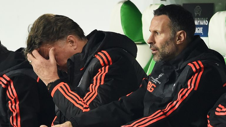 A dejected Manchester United manager Louis van Gaal  (left) with assistant Ryan Giggs
