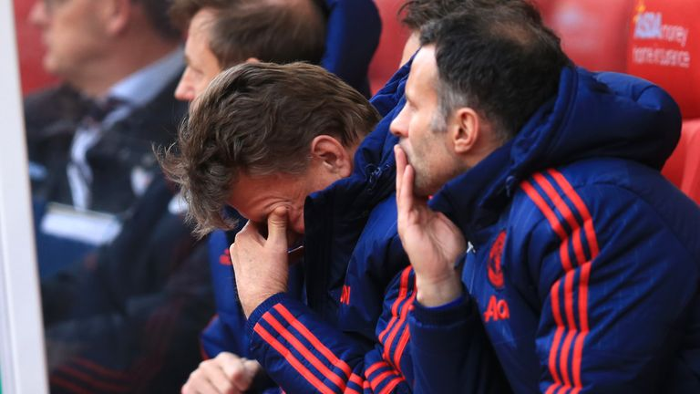 Manchester United manager Louis van Gaal sits dejected on the bench during the Barclays Premier League match at the Britannia Stadium, Stoke