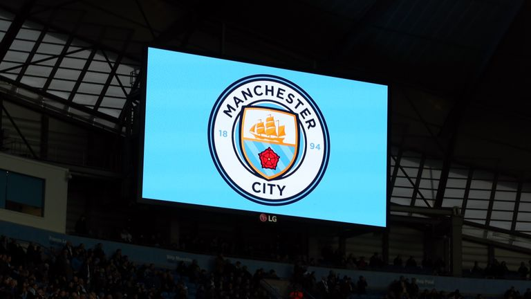 The new Manchester City club crest is displayed on the big screen before the Premier League match against Sunderland at the Etihad Stadium.