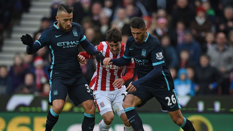 Manchester City's Argentine centre-backs Nicolas Otamendi and Martin Demichelis endured a tough afternoon at the Potteries on Saturday
