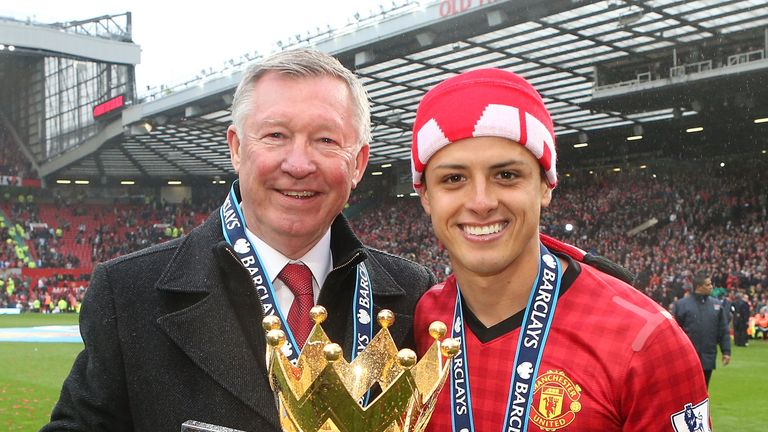 Manchester United manager Sir Alex Ferguson and Javier Hernandez celebrate with the Premier League trophy in 2013