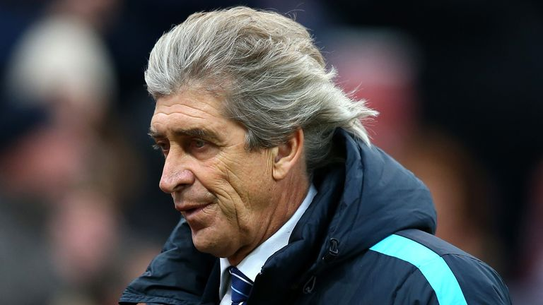 STOKE ON TRENT, ENGLAND - DECEMBER 05:  Manuel Pellegrini, manager of Manchester City shows his dejection after the Barclays Premier League match between S