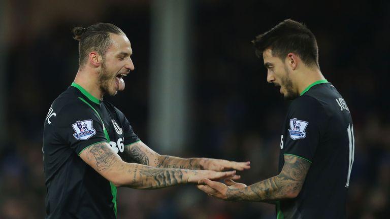 Marko Arnautovic (L) celebrates scoring Stoke City's winning goal with his team mate Joselu (R) during the match against Everton