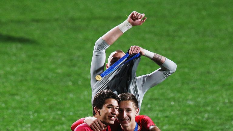Reported Liverpool target Marko Grujic (left) celebrates after winning the U20 World Cup with Serbia