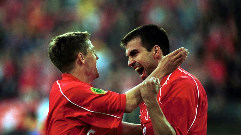Markus Babbel celebrates with teammate Michael Owen after scoring the opening goal for Liverpool during the UEFA Cup Final