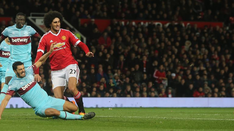 Marouane Fellaini and James Tomkins clashed at Old Trafford on Saturday