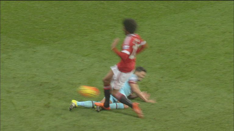 Fellaini appeared to plant his right foot on the shin of Tomkins