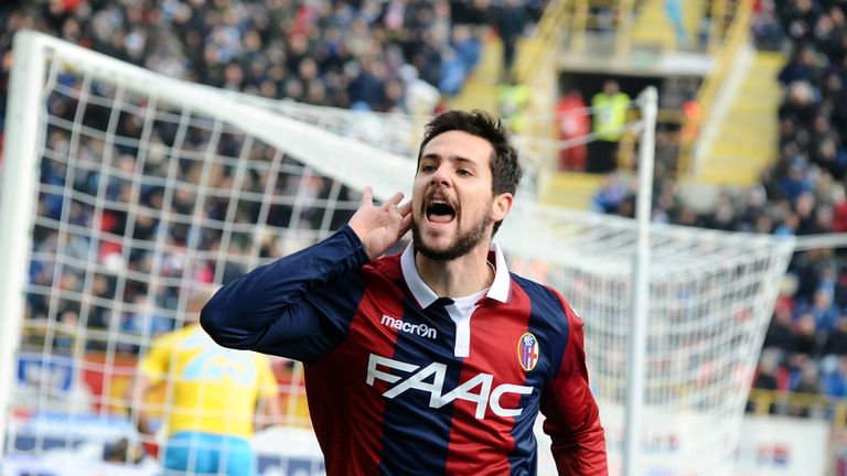 Mattia Destro celebrates after scoring the opening goal for Bologna against Napoli