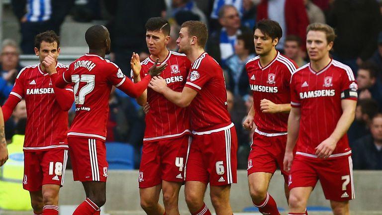 Albert Adomah of Middlesbrough celebrates with Daniel Ayalaand team-mates