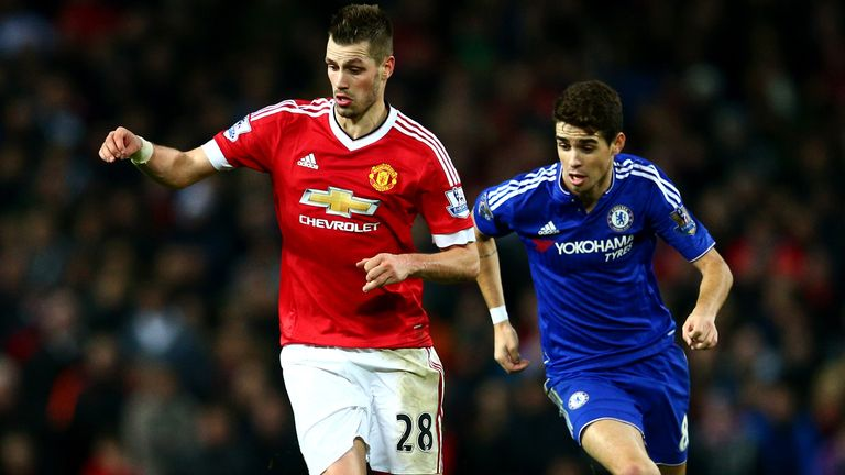 MANCHESTER, ENGLAND - DECEMBER 28:  Morgan Schneiderlin of Manchester United battles for the ball with Oscar of Chelsea during the Barclays Premier League