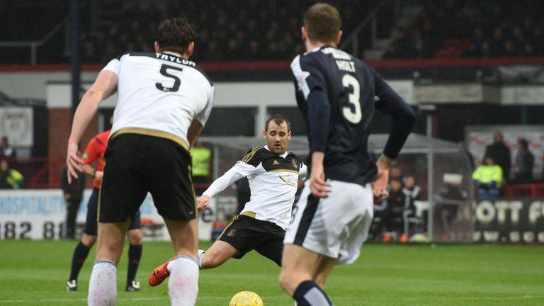 Niall McGinn hooks home the opener