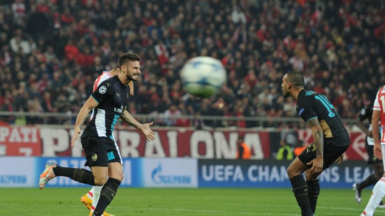 Olivier Giroud and Theo Walcott celebrate one of the Frenchman's three Arsenal goals at Olympiakos
