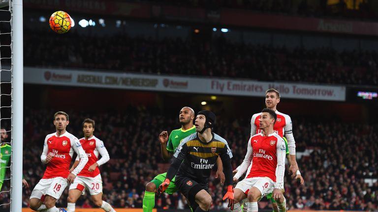 Arsenal goalkeeper Petr Cech watches as  Giroud's own goal puts Sunderland level at 1-1