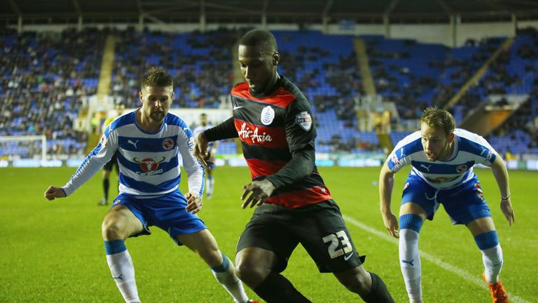 Junior Hoilett is watched by Oliver Norwood and Chris Gunter