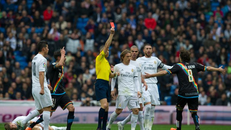 The referee shows a red card to Rayo Vallecano's midfielder Jose Raul Baena