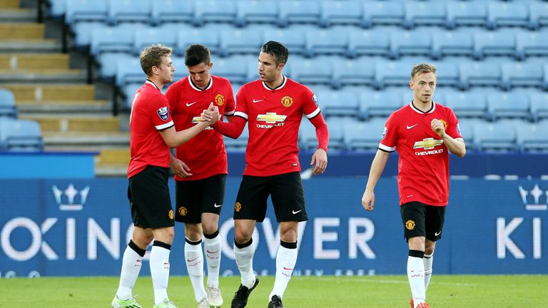 Goss is congratulated by Robin Van Persie after scoring against Leicester