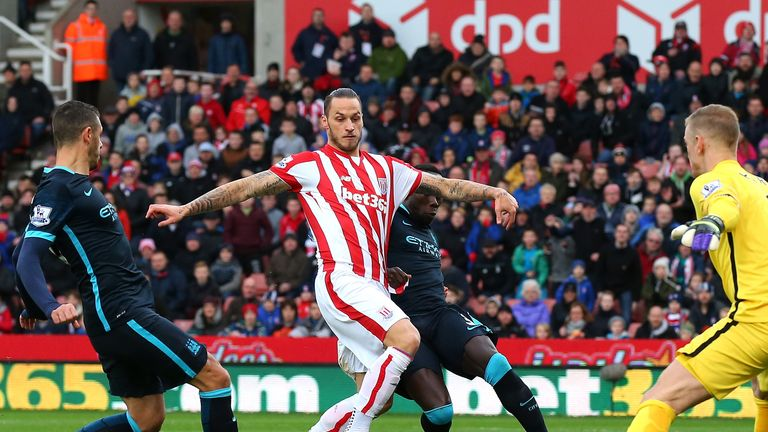 Stoke's Marko Arnautovic nips in ahead of City right-back Bacary Sagna to open the scoring at the Britannia on Saturday