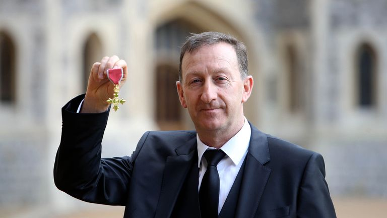Swansea City chairman Huw Jenkins with his OBE