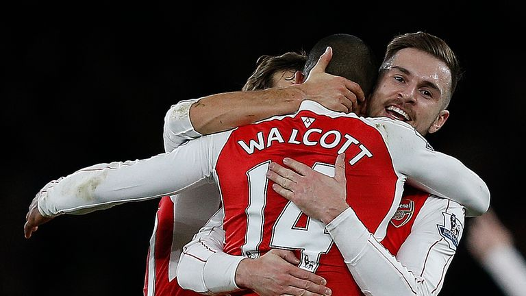 Arsenal's Theo Walcott (C) celebrates with Aaron Ramsey (R) after scoring his team's first goal