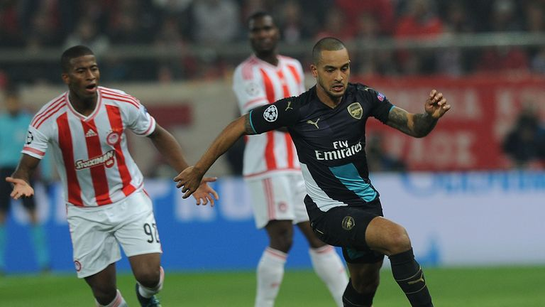Arsenal forward Theo Walcott (right) in action against Olympiakos
