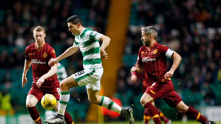 Celtic's Tomas Rogic (centre) battles for the ball with Motherwell's Stephen Pearson (left) and Keith Lasley