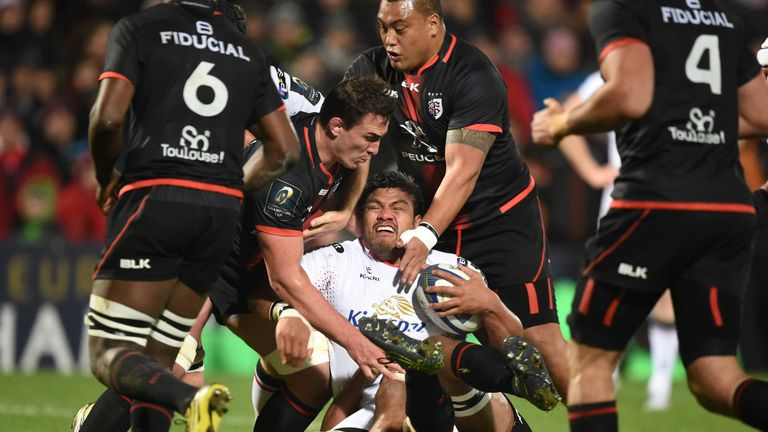 Nick Williams who scored Ulster's opening try is swamped  by the Toulouse defence