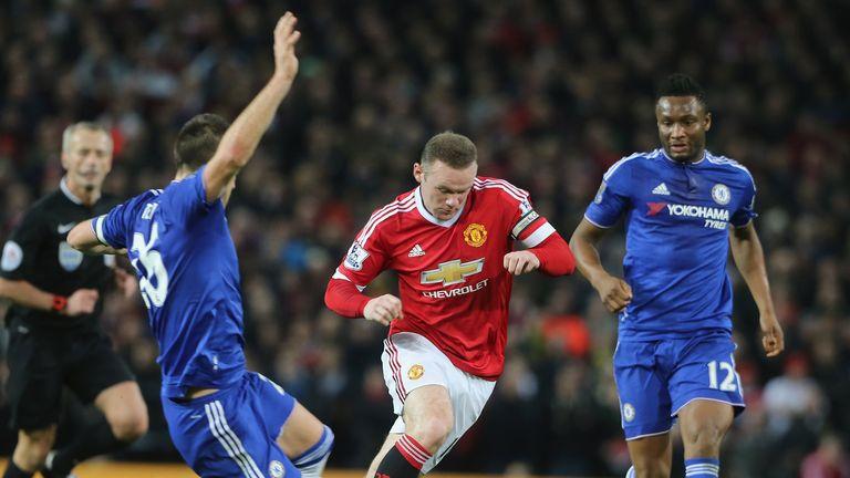 Wayne Rooney moves away from John Terry