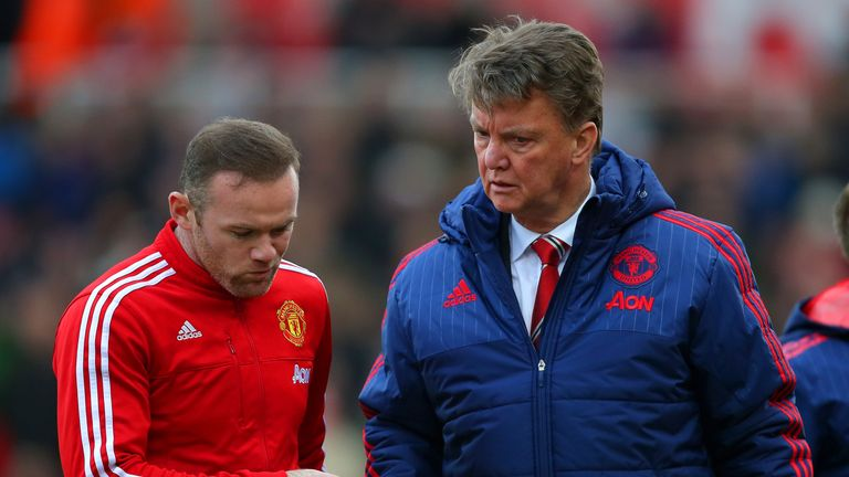 Louis van Gaal, manager of Manchester United speaks with Wayne Rooney of Manchester United during the Barclays Premier League