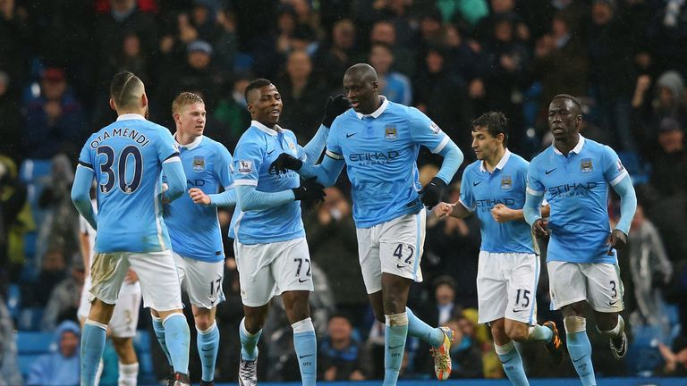 Yaya Toure celebrates scoring his team's second goal with his team mates during the Barclays Premier League match between Manchester City and Swansea City