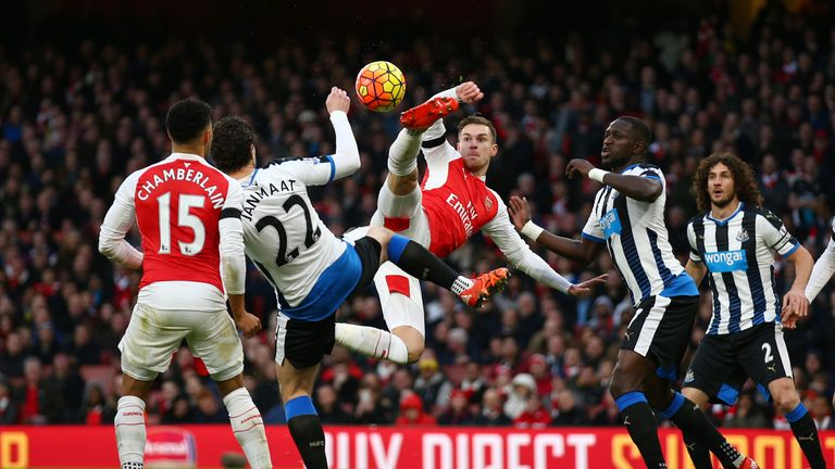 Aaron Ramsey of Arsenal and Daryl Janmaat of Newcastle United compete for the ball