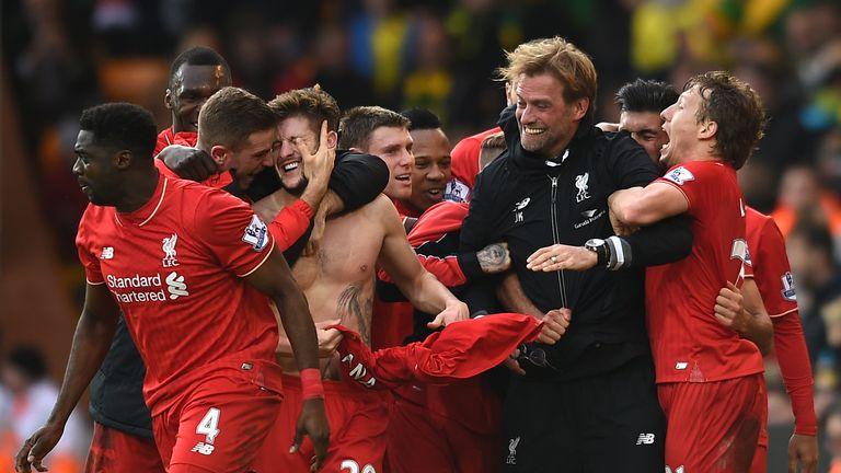 Liverpool's Adam Lallana (20) celebrates with his team-mates and manager Jurgen Klopp