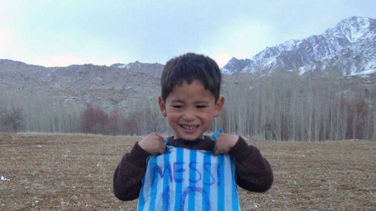 Murtaza Ahmadi, 5, with his plastic bag jersey