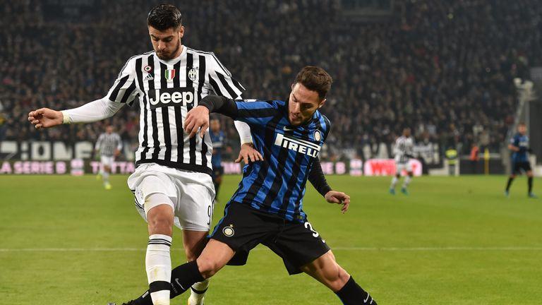 Alvaro Morata (L) of Juventus FC is challenged by Danilo D Ambrosio of Inter Milan