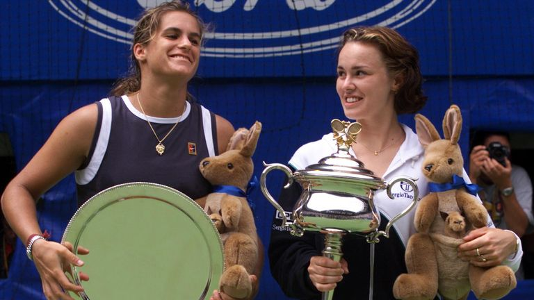 Amelie Mauresmo and Hingis at the Australian Open trophy ceremony in 1999