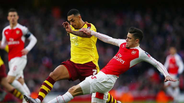 Andre Gray and Gabriel compete for the ball