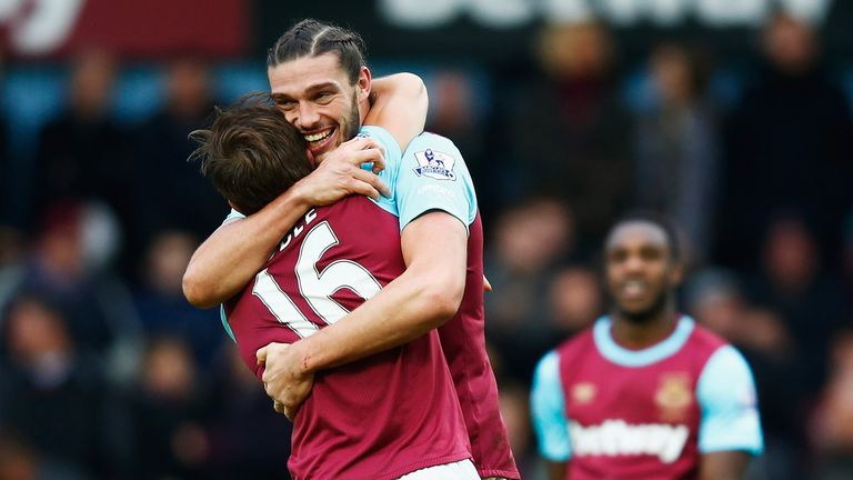 Carroll and Mark Noble embrace after West Ham's second