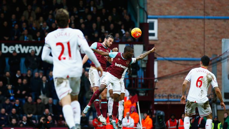 Andy Carroll (second left) scores West Ham's second goal