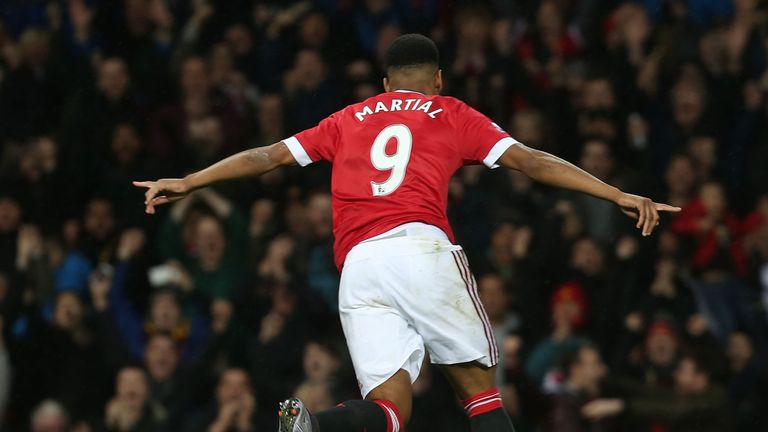 Anthony Martial celebrates scoring Manchester United's first goal during the Barclays Premier League match against Swansea City