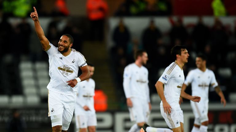 Williams of Swansea City celebrates after scoring the opening goal.
