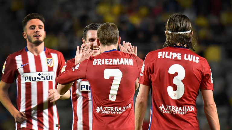 Atletico Madrid's French forward Antoine Griezmann (7) celebrates with teammates after scoring during the